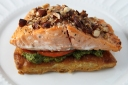 Salmon with Puff Pastry, Pesto, Tomatoes, and Almonds