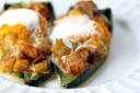Poblanos Peppers Stuffed with Curried Shrimp, Scallops, and Andouille and topped with Carrot Puree and Creme Fraiche